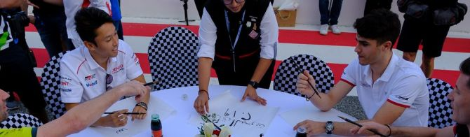 WEC drivers try their skills at Arabic calligraphy!